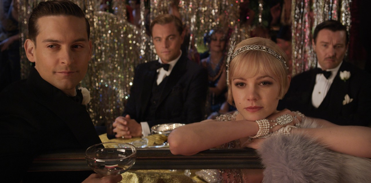 Image of Nick (Tobey Maguire), Gatsby (Leonardo DiCaprio), Daisy (Carey Mulligan), and Tom (Joel Edgerton) in the 2013 film The Great Gatsby