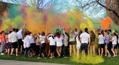 On April 26, students throw powder at each other and in the air as part of the Festival of Colors, which was put on by the TSO group MESA and business students in the Management Analysis and Practice class.