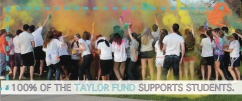 """Front of Taylor Fund mailer, with picture of students throwing colored powder. Text reads, """"100% of the Taylor Fund supports students."""""""